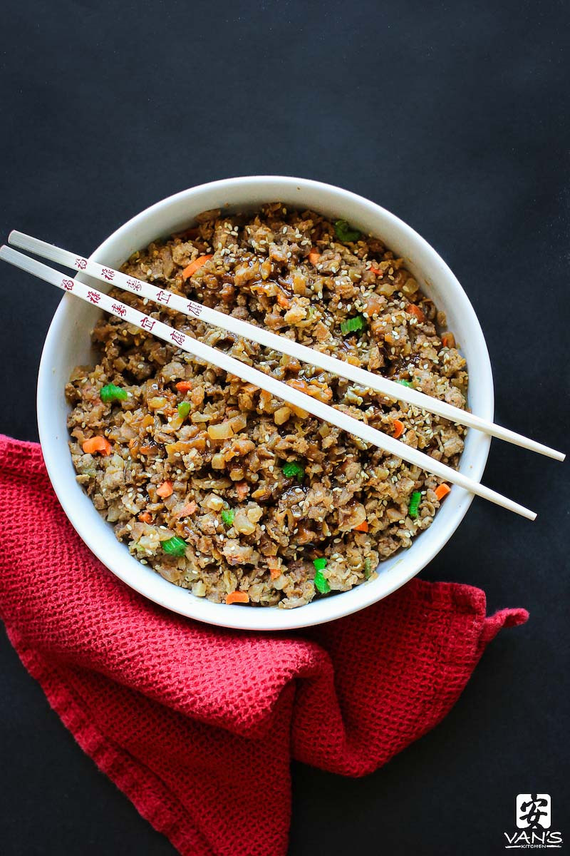 """Need a low-carb dinner idea? Try this fried cauliflower rice recipe made with Van's Kitchen egg rolls. It's a healthy spin on classic takeout fried rice. This recipe is so light, fluffy, and tasty, you may never go back to """"real"""" fried rice again!"""